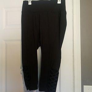 Black workout capri leggings with bottom crisscros